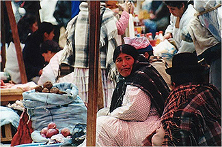 A woman in a marketplace.